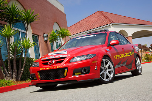 AUT 42 RK0207 01 © Kimball Stock 2007 Mazda Speed 6 Official Pace Car Red Low 3/4 Front View On Pavement