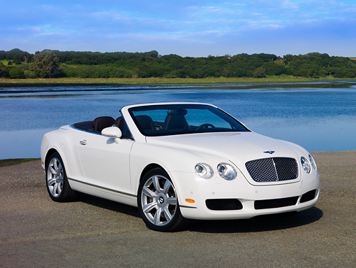 AUT 42 RK0209 01 © Kimball Stock 2007 Bentley GTC Convertible White 3/4 Front View On Pavement By Water