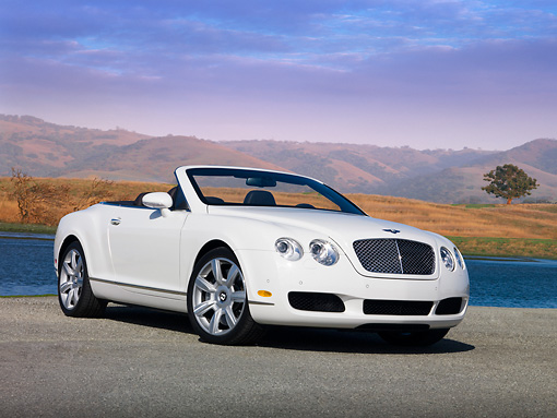 AUT 42 RK0211 01 © Kimball Stock 2007 Bentley GTC Convertible White Low 3/4 Front View On Pavement By Water