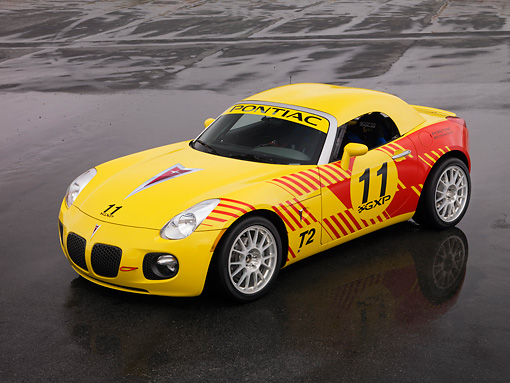 AUT 42 RK0213 01 © Kimball Stock 2007 Pontiac Solstice GXP Club Racing Yellow And Red 3/4 Front View On Pavement