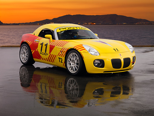 AUT 42 RK0214 01 © Kimball Stock 2007 Pontiac Solstice GXP Club Racing Yellow And Red 3/4 Front View On Pavement