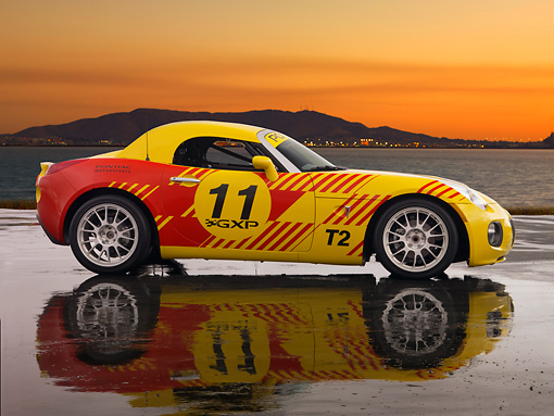 AUT 42 RK0215 01 © Kimball Stock 2007 Pontiac Solstice GXP Club Racing Yellow And Red 3/4 Side View On Pavement