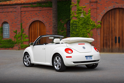 AUT 42 RK0216 01 © Kimball Stock 2007 Volkswagen New Beetle Convertible White 3/4 Rear View On Pavement