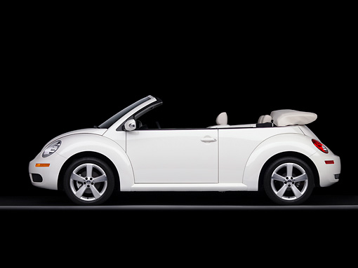 AUT 42 RK0243 01 © Kimball Stock 2007 Volkswagen New Beetle Convertible White Profile View Studio