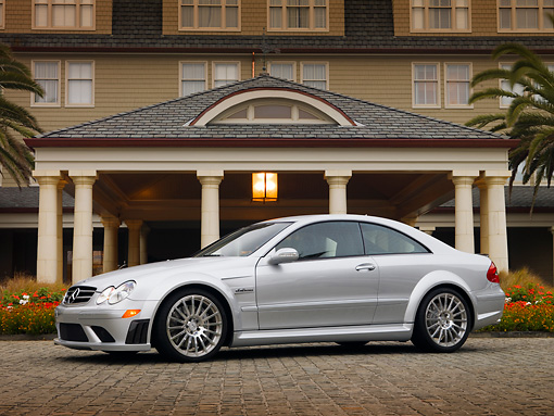 AUT 42 RK0250 04 © Kimball Stock 2007 Mercedes-Benz CLK63 AMG Black Series Silver Coupe 3/4 Front View On Pavement