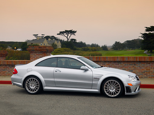 AUT 42 RK0251 01 © Kimball Stock 2007 Mercedes-Benz CLK63 AMG Black Series Silver Coupe 3/4 Front View On Pavement