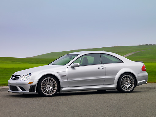 AUT 42 RK0258 01 © Kimball Stock 2007 Mercedes-Benz CLK63 AMG Black Series Silver Coupe Front 3/4 View On Pavement
