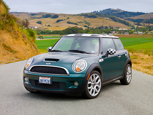 AUT 43 BK0016 01 © Kimball Stock 2007 Mini Cooper S Green And Checkered 3/4 Front View On Road By Grassy Hills