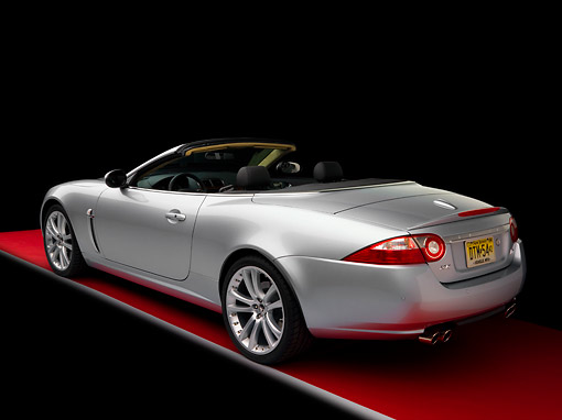AUT 43 RK0100 02 © Kimball Stock 2008 Jaguar XKR Convertible Silver 3/4 Rear View Studio