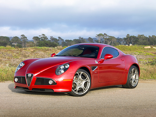 AUT 43 RK0409 01 © Kimball Stock 2008 Alfa Romeo 8C Competizione Red 3/4 Front View On Pavement By Field