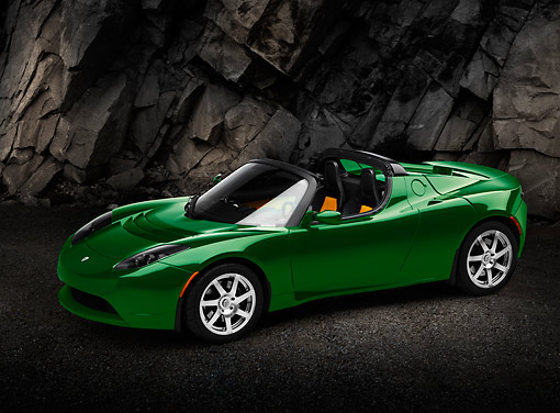 AUT 43 RK0414 01 © Kimball Stock 2008 Tesla Roadster Hybrid Green 3/4 Side View On Pavement By Rock Wall