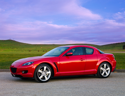 AUT 43 BK0002 01 © Kimball Stock 2008 Mazda RX-8 Red 3/4 Front View On Pavement By Hills