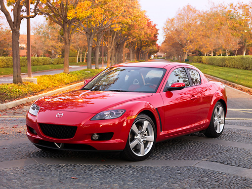 AUT 43 BK0005 01 © Kimball Stock 2008 Mazda RX-8 Red 3/4 Front View On Pavement By Autumn Trees