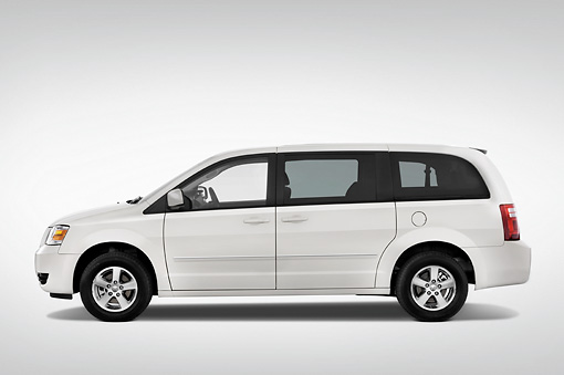 AUT 43 IZ0170 01 © Kimball Stock 2010 Dodge Grand Caravan SXT White Profile View Studio