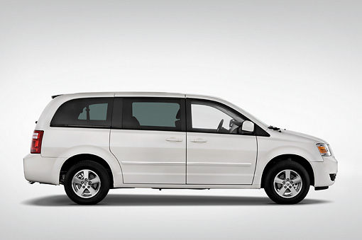 AUT 43 IZ0171 01 © Kimball Stock 2010 Dodge Grand Caravan SXT White Profile View Studio