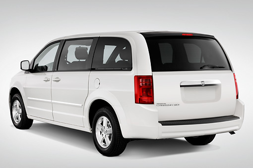 AUT 43 IZ0174 01 © Kimball Stock 2010 Dodge Grand Caravan SXT White 3/4 Rear View Studio
