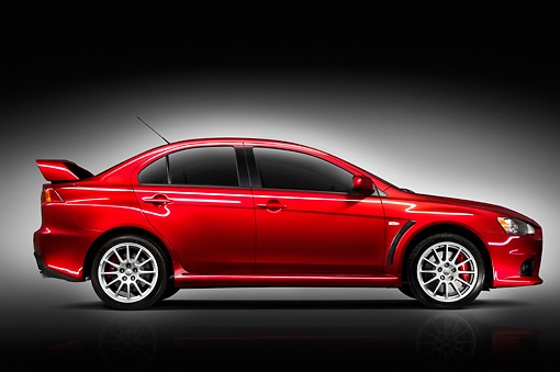 AUT 43 IZ0190 01 © Kimball Stock 2008 Mitsubishi Lancer Evolution Red Profile View Studio
