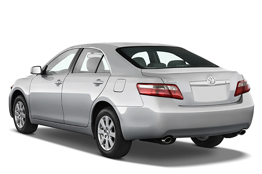 AUT 43 IZ0297 01 © Kimball Stock 2009 Toyota Camry XLE Silver 3/4 Rear View Studio