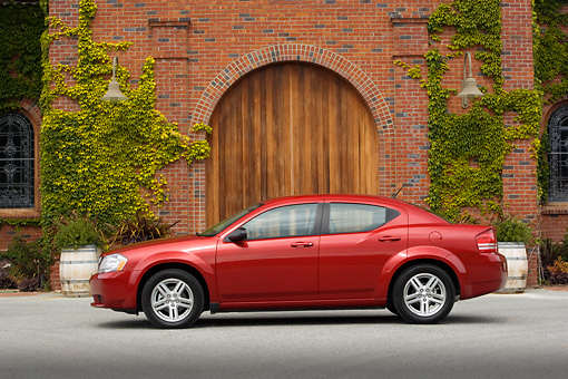 AUT 43 RK0026 01 © Kimball Stock 2008 Dodge Avenger Red Profile View On Pavement