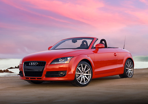 AUT 43 RK0032 01 © Kimball Stock 2008 Audi TT Convertible Red Low 3/4 Front View On Sand