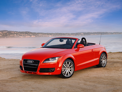 AUT 43 RK0034 01 © Kimball Stock 2008 Audi TT Convertible Red 3/4 Front View On Sand