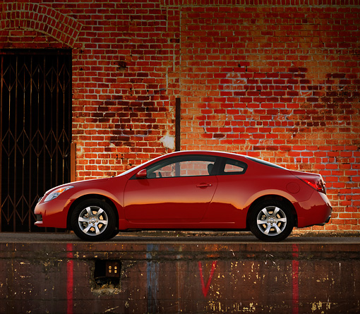 AUT 43 RK0059 01 © Kimball Stock 2008 Nissan Altima 2-Door Coupe Red Profile View On Pavement
