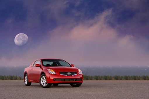 AUT 43 RK0060 01 © Kimball Stock 2008 Nissan Altima 2-Door Coupe Red Front 3/4 View On Pavement Moon Clouds