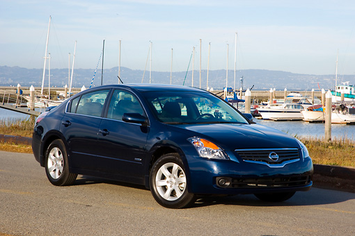 AUT 43 RK0083 01 © Kimball Stock 2008 Nissan Altima Hybrid Dark Blue 3/4 Front View On Pavement By Marina Sky