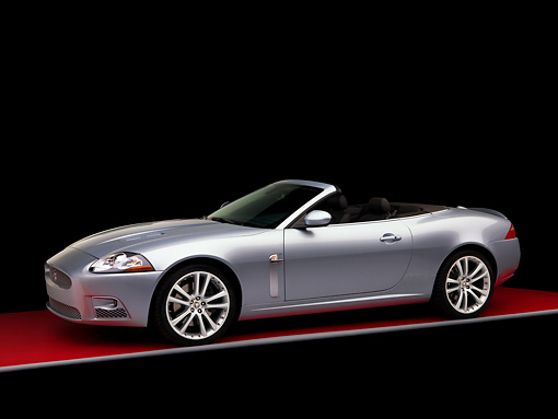 AUT 43 RK0098 01 © Kimball Stock 2008 Jaguar XKR Convertible Silver 3/4 Front View Studio