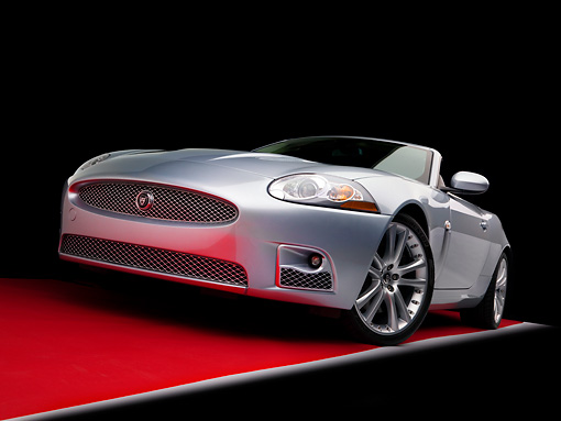 AUT 43 RK0099 01 © Kimball Stock 2008 Jaguar XKR Convertible Silver 3/4 Front View Low Studio