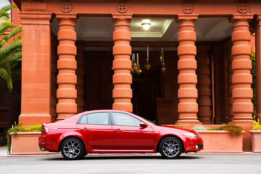 AUT 43 RK0130 01 © Kimball Stock 2008 Acura TL Type-S HPT Red Profile View By Building