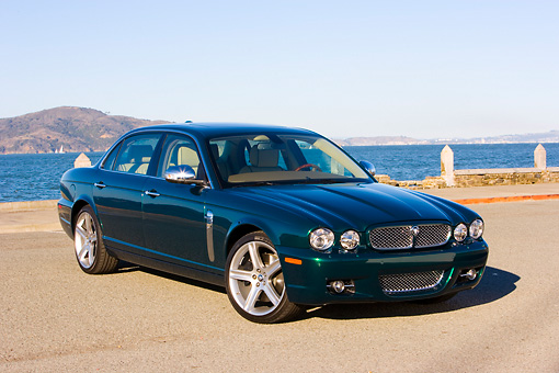 AUT 43 RK0170 01 © Kimball Stock 2008 Jaguar XJ Super V8 Green 3/4 Front View By Water