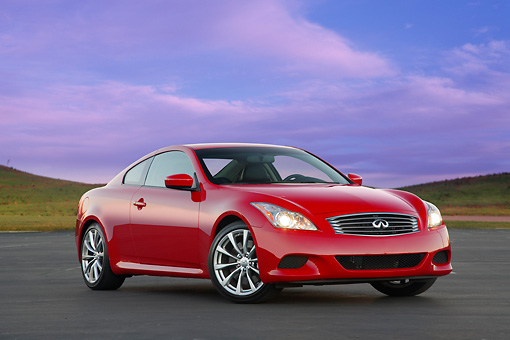 AUT 43 RK0220 01 © Kimball Stock 2008 Infiniti G37 Sport 6MT Red 3/4 Front View On Pavement By Trees