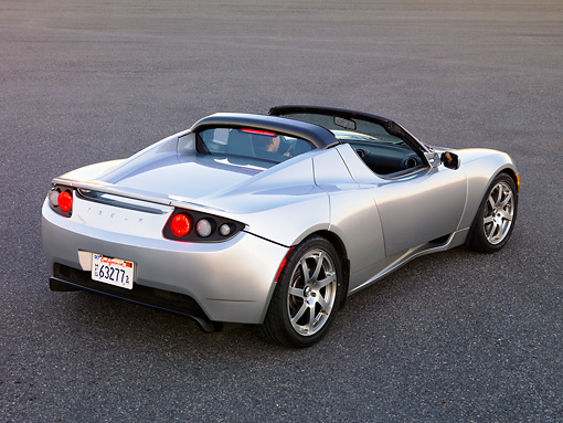 AUT 43 RK0230 01 © Kimball Stock 2008 Tesla Roadster Silver 3/4 Rear View On Pavement