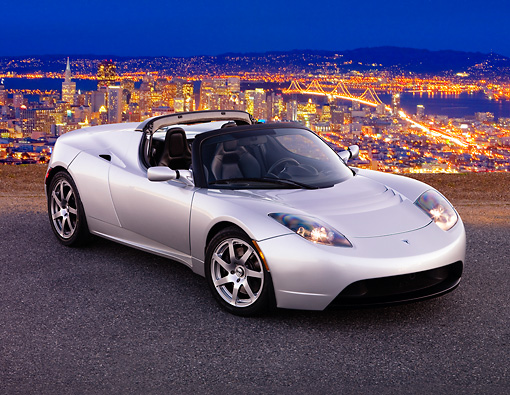 AUT 43 RK0233 01 © Kimball Stock 2008 Tesla Roadster Silver 3/4 Front View On Pavement