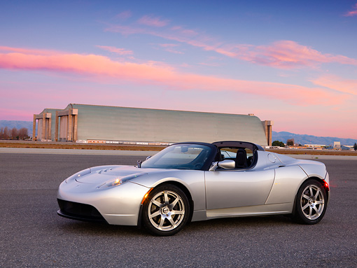 AUT 43 RK0234 01 © Kimball Stock 2008 Tesla Roadster Silver 3/4 Front View On Pavement
