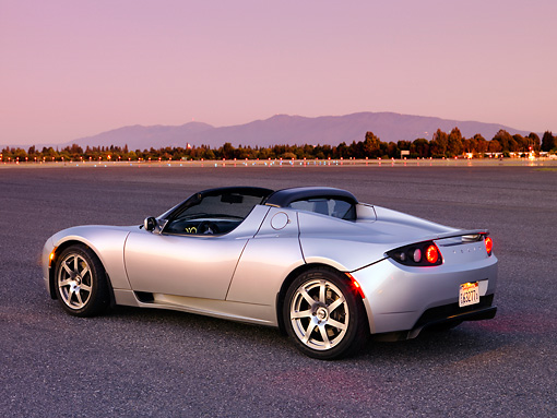 AUT 43 RK0235 01 © Kimball Stock 2008 Tesla Roadster Silver 3/4 Rear View On Pavement