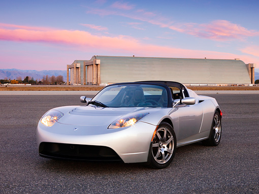 AUT 43 RK0236 01 © Kimball Stock 2008 Tesla Roadster Silver 3/4 Front View On Pavement