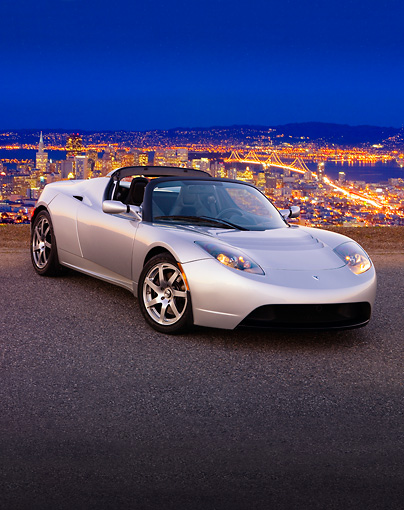AUT 43 RK0239 01 © Kimball Stock 2008 Tesla Roadster Silver 3/4 Front View On Pavement