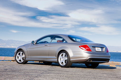 AUT 43 RK0278 01 © Kimball Stock 2008 Mercedes-Benz CL550 Pewter 3/4 Rear View By Water Blue Sky