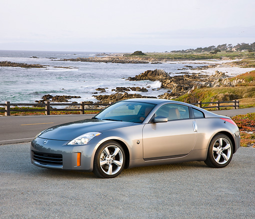 AUT 43 RK0319 01 © Kimball Stock 2008 Nissan 350Z Silver 3/4 Front View On Pavement By Trees