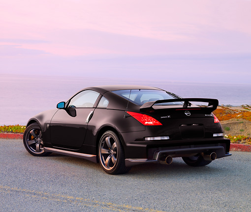 AUT 43 RK0324 01 © Kimball Stock 2008 Nissan NISMO 350Z Black 3/4 Rear View At Dusk