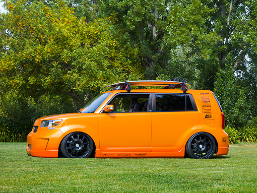 AUT 43 RK0335 01 © Kimball Stock 2008 Scion xB Orange 3/4 Front View By Trees