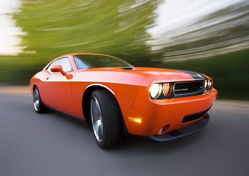 AUT 43 RK0373 01 © Kimball Stock 2008 Dodge Challenger SRT8 Orange 3/4 Front View On Road By Trees