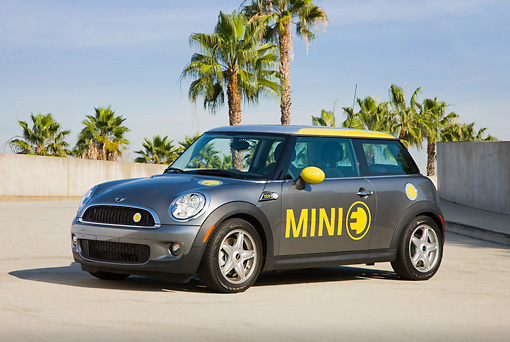 AUT 43 RK0379 01 © Kimball Stock 2008 Mini E Gray And Yellow 3/4 Front View On Pavement By Palm Trees