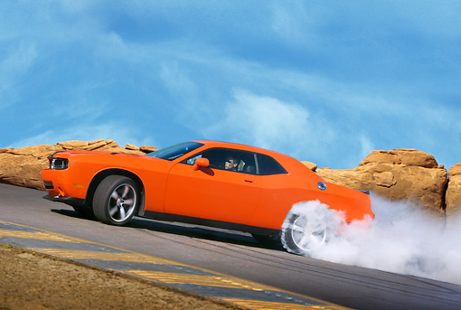 AUT 43 RK0388 01 © Kimball Stock 2008 Dodge Challenger SRT8 Orange Burning Tires On Pavement