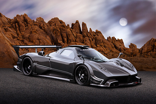 AUT 44 BK0007 01 © Kimball Stock 2009 Pagani Zonda R Gray 3/4 Front View On Pavement By Red Rock And Moon
