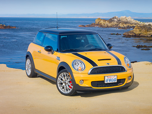 AUT 44 RK0070 01 © Kimball Stock 2009 Mini Cooper Yellow And Black 3/4 Front View By Ocean