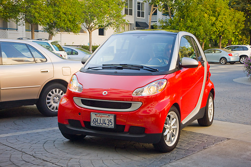 AUT 44 RK0080 01 © Kimball Stock 2009 Smart Fortwo Passion Coupe Red And Silver 3/4 Front View On Pavement