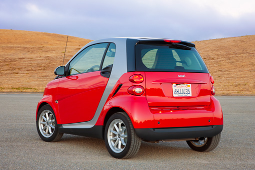 AUT 44 RK0088 01 © Kimball Stock 2009 Smart Fortwo Passion Coupe Red And Silver 3/4 Rear View On Pavement By Hills